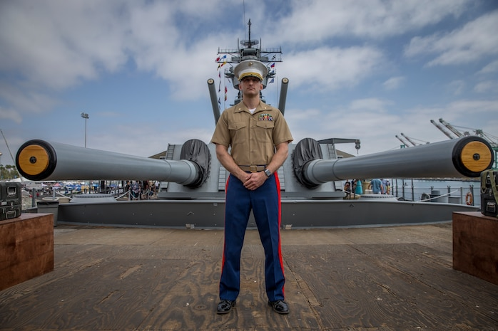 U.S. Marine Corps Maj. Scott Sasser, a media operations officer with I Marine Expeditionary Force, poses for a photo following his promotion ceremony where he was promoted from Captain to Major aboard the USS Iowa during Los Angeles Fleet Week, Sept. 1, 2018. The residents of San Pedro, Calif., were invited to view the promotion as Sasser was promoted from a company-grade officer to a field-grade officer. Commissioned officer ranks are subdivided into generals, field-grade, and company-grade officers. Through fleet weeks, the military gains the opportunity to educate area leaders and the general public about the Marine Corps and Navy.