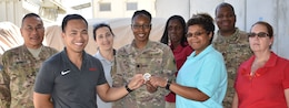 The Contracting team receives a Transatlantic Division coin for expediting the contract award schedule for the Design and construction of Entry Control Point #3 at Bagram Airfield, Parwan Province, Afghanistan. 