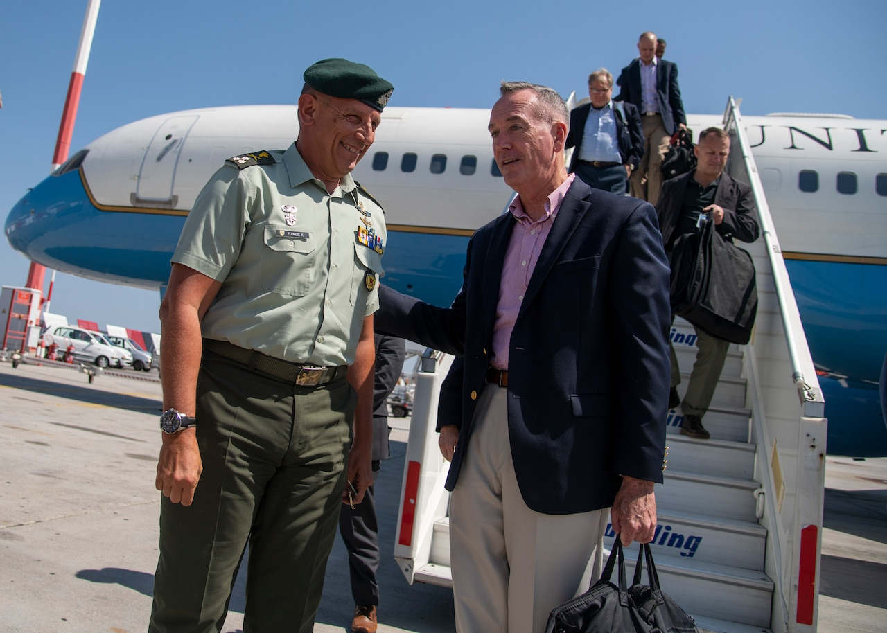 A Greek soldier welcomes Marine Corps Gen. Joe Dunford, chairman of the Joint Chiefs of Staff, to Athens, Greece.