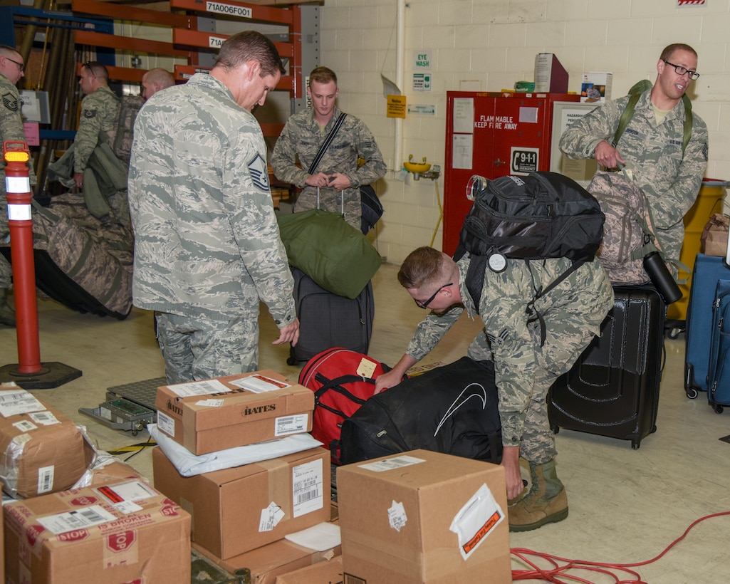 Master Sgt. RN, JTU, weighs Airmen's bags August 29, 2018, in the deployment proccessing center at the 115th Fighter Wing, Truax Field, Wisconsin. Approximately 30 Airmen with the 115th Force Support Squadron are going TDY to Ramstein Air Base, Germany.(U.S. Air National Guard photo by Airman 1st Class Cameron Lewis)