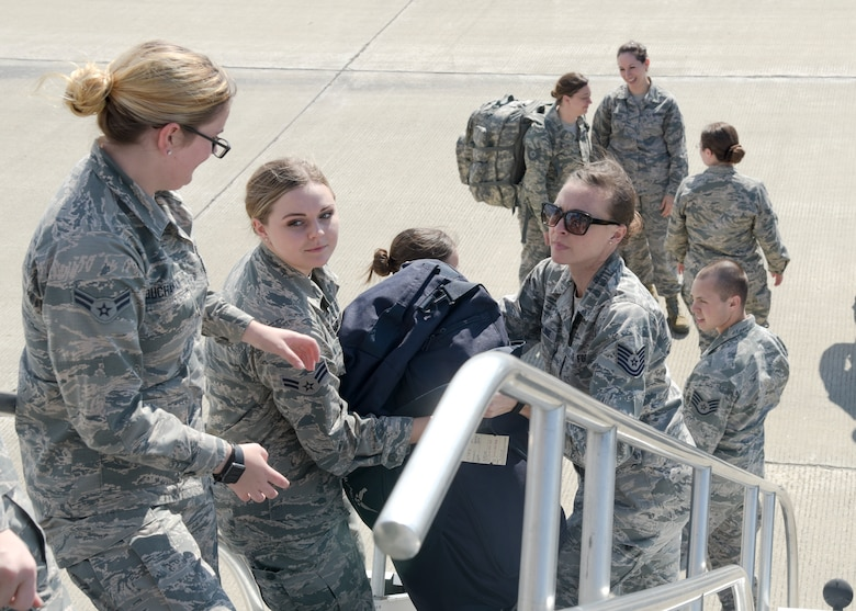 Airman 1st Class Tiana Buchanan, Airman 1st Class Lauren Ludka, and Tech. Sgt. Angela Krepline, all with the 115th Force Support Squadron, Truax Field, Wisconsin, load bags onto a KC-135 Stratotanker, assigned to the 128th Air Refueling Wing, General Mitchell Air National Guard Base, Wisconsin, before departing from Truax Field to Ramstein Air Base, Germany Aug. 29, 2018. The 115th FSS is going TDY to Ramstein for approximately two-weeks as part of a movement for training mission. (U.S. Air National Guard photo by Airman 1st Class Cameron Lewis)