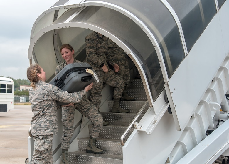 Airman 1st Class Eliza Rushlow and Airman 1st Class Kaitlin Berry, both personnelist with the 115th Force Support Squadron, Truax Field, Wisconsin, unload baggage from a KC-135 Stratotanker, assigned to the 128th Air Refueling Wing, General Mitchell Air National Guard Base, Wisconsin, Aug. 30, 2018, at Ramstein Air Base, Germany. The 115th FSS is TDY to Ramstein for approximately two-weeks as part of a movement for training mission. (U.S. Air National Guard photo by Airman 1st Class Cameron Lewis)