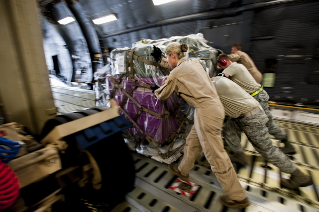 Airmen from the 39th Logistics Readiness Squadron, the 728th Air Mobility Squadron and the 9th Airlift Squadron unload equipment from a C-5M Super Galaxy from Dover Air Force Base, Del., in support of Operation Inherent Resolve Aug. 9, 2015, at Incirlik Air Base, Turkey. The U.S. Air Force deployed six F-16 Fighting Falcons from Aviano Air Base, Italy, support equipment and approximately 300 personnel to Incirlik AB.