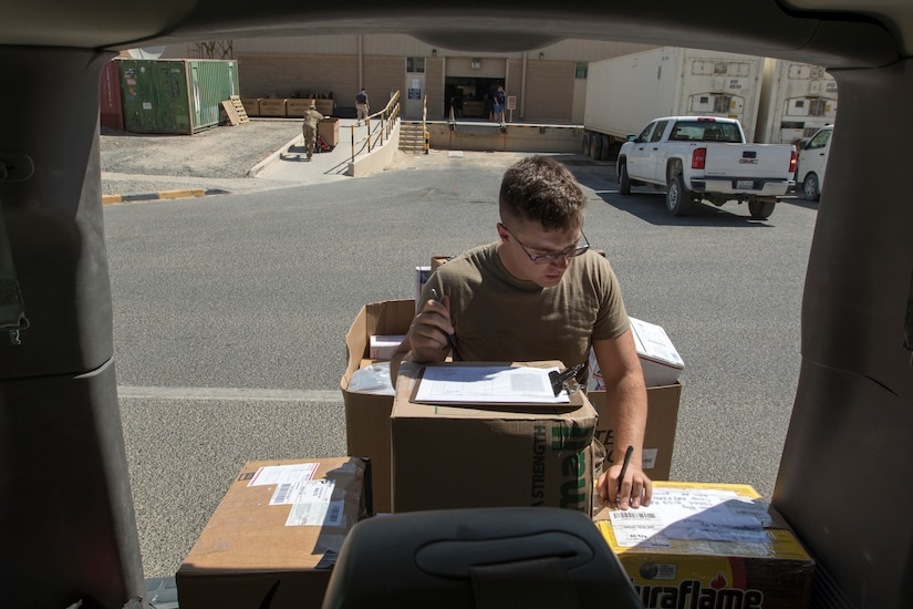 U.S. Army Spc. James Day, a human resources specialist with the 151st Regional Support Group, Massachusetts Army National Guard, attached to U.S. Army Central, marks packages with sorting codes before transporting them from the main post office to the USARCENT mail room at Camp Arifjan, Kuwait, Aug. 20, 2018. Consistent mail delivery in a deployed environment is a critical capability for overseas units.