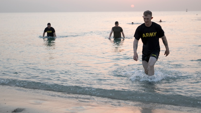 U.S. Army Soldiers competing in the 74th Engineer Dive Detachment's Diver Fitness Challenge wade ashore after completing the 200 meter swim event at Kuwait Naval Base, Kuwait, Aug. 31, 2018. The events of the Diver Fitness Challenge are not exercises typically done by Soldiers in the U.S. Army, so they provide a unique opportunity for Soldiers to increase their capabilities by trying new challenges.