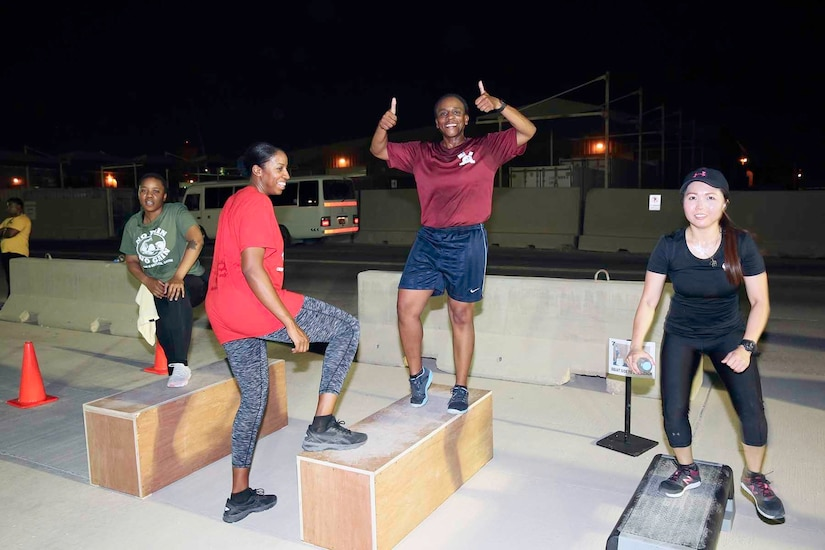 U.S. Army Command Sgt. Maj. Cynthia Reed of Area Support Group-Qatar gives a smile and thumbs-up at the Sisters in Arms circuit training event at Camp As-Sayliyah, Qatar, August 23, 2018.