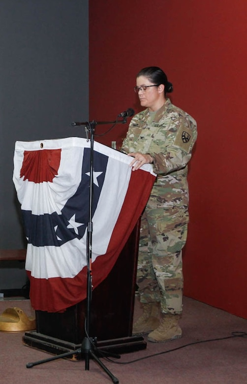 U.S. Army Col. Robin Julch commander of 310th Human Resources Sustainment Center, 1st Sustainment Command (Theater) gives the keynote address during the Women's Equality Day observation at Camp As-Sayliyah, Qatar, August 23, 2018. Julch paid tribute to strong women leaders in our country's and military's history.