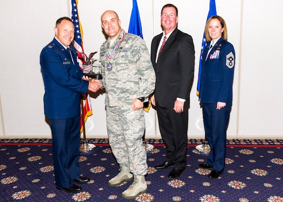 Maj. TJ Turner was recently awarded the Air Force Office of Special Investigations Individual Mobilization Augmentee of the year award. Pictured left to right are Col. Kirk Stabler, Commander, AFOSI, Maj. TJ Turner, Mr. Jeffrey Specht, Executive Director, AFOSI and Chief Master Sgt. Karen Beirne Flint, Command Chief, AFOSI. (U.S. Air Force courtesy photo)