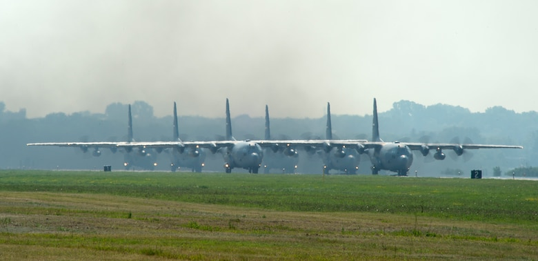 U.S. Air Force C-130 Hercules' from the 109th and 96th Airlift Squadrons, prepare for take-off in St. Paul, Minn., Aug. 8, 2018.