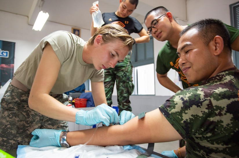 daho Army National Guard Sgt. Mikki Fritz, a combat medic, gives a medic from the Thai army an IV as part of medical training during the Hanuman Guardian 2018 exercise at the Cavalry Center in Saraburi province, Thailand.