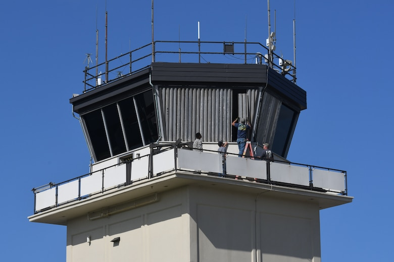 Keesler personnel board up the windows surrounding the air traffic control tower on Keesler Air Force Base, Mississippi, Sept. 4, 2018. Safety measures are being taken around the base to prepare for the arrival of Hurricane Gordon to the Gulf Coast Sept. 4. (U.S. Air Force photo by Kemberly Groue)