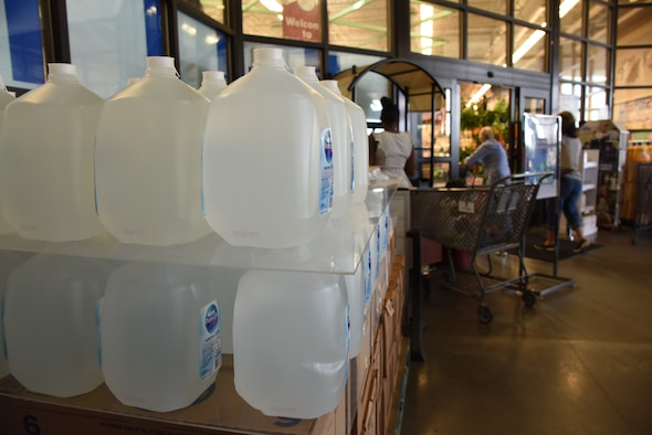 Jugs of water are on sale at the entrance of the Commissary on Keesler Air Force Base, Mississippi, Sept. 4, 2018. Safety measures are being taken around the base to prepare for the arrival of Hurricane Gordon to the Gulf Coast Sept. 4. (U.S. Air Force photo by Kemberly Groue)