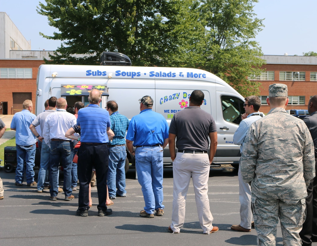 Arnold Air Force Base personnel line up to place their orders with Crazy Daisies. The Crazy Daisies food truck, located in the parking lot of the Main Auditorium, opened for business at Arnold AFB on Aug. 14. (U.S. Air Force photo by Bradley Hicks)