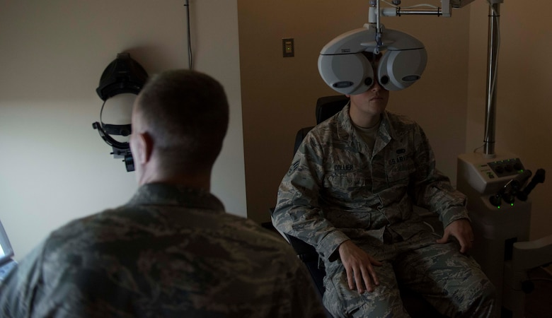 U.S. Air Force Maj. Ronny Bowman, 20th Aerospace Medicine Squadron optometry flight commander, left, tests Senior Airman Samuel Collier, 20th Operational Support Squadron raws technician, for astigmatism at Shaw Air Force Base, S.C., Sept. 4, 2018.