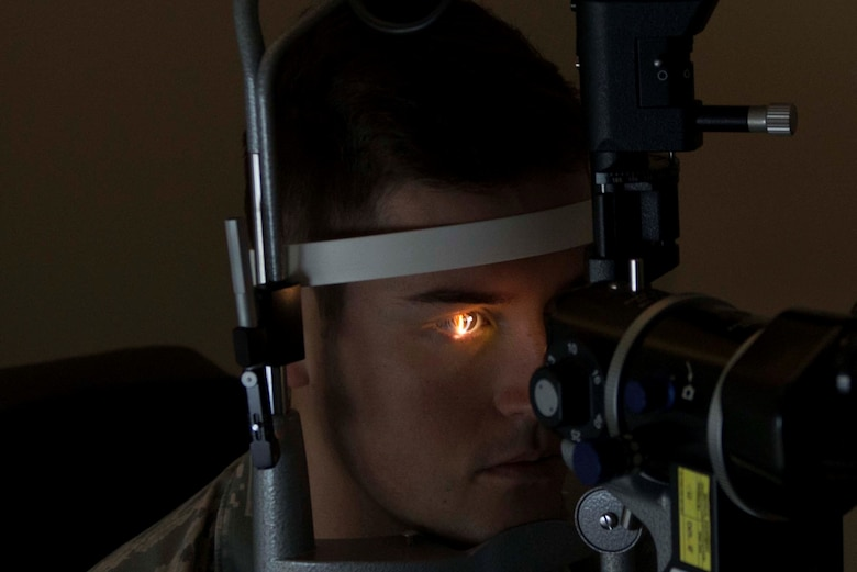 U.S. Air Force Senior Airman Samuel Collier, 20th Operational Support Squadron raws technician, has his eyes examined at Shaw Air Force Base, S.C., Sept. 4, 2018.