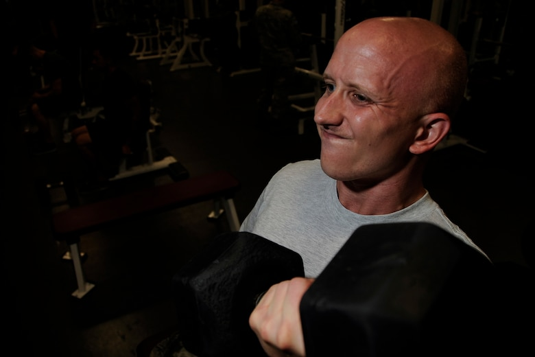 Staff Sgt. Justin Norton, a 302nd Airlift Wing Public Affairs photojournalist, lifts weights, Aug. 16, 2018, at Peterson Air Force Base, Colorado.