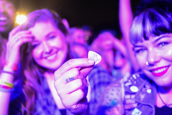 Logan Hall shows off the guitar pick she caught during the End of Summer Music Festival performance Sept. 2, 2018, at Dover Air Force Base, Del. The opportunity to host a concert involving rock bands We the Kings and X Ambassadors came through Air Force Entertainment. (U.S. Air Force photo by Airman 1st Class Dedan Dials)