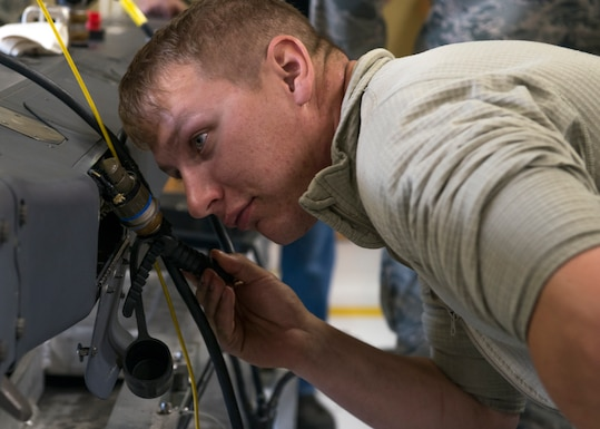 Staff Sgt. Walter Mueller, 366th Equipment Maintenance Squadron armament maintenance technician, checks the Common Munitions Built-in Test Reprogramming Equipment (CMBRE) connection to the Bomb Rack Unit-61 Aug. 28, 2018 at Mountain Home Air Force Base, Idaho. The 366th Equipment Maintenance Squadron conducted in-depth F-15E Strike Eagle armament training Aug. 27-30 that will enhance the 366th Fighter Wing's readiness down-range. (U.S. Air Force photo by Airman 1st Class JaNae Capuno)