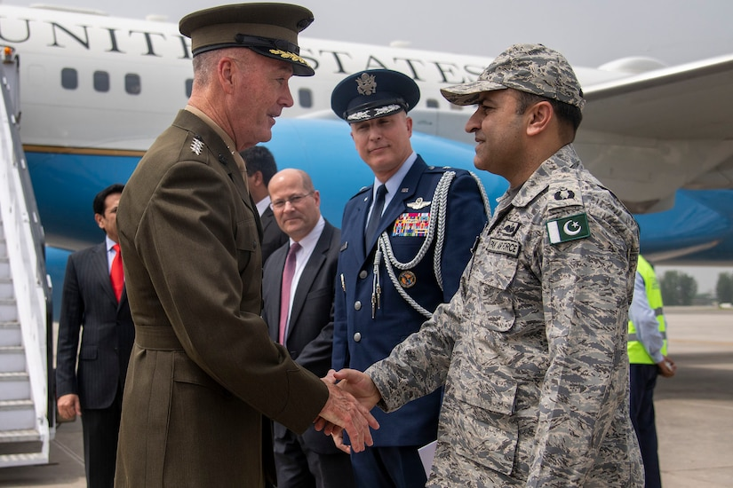 Marine Corps Gen. Joe Dunford, chairman of the Joint Chiefs of Staff, shakes hands with a Pakistani military official.