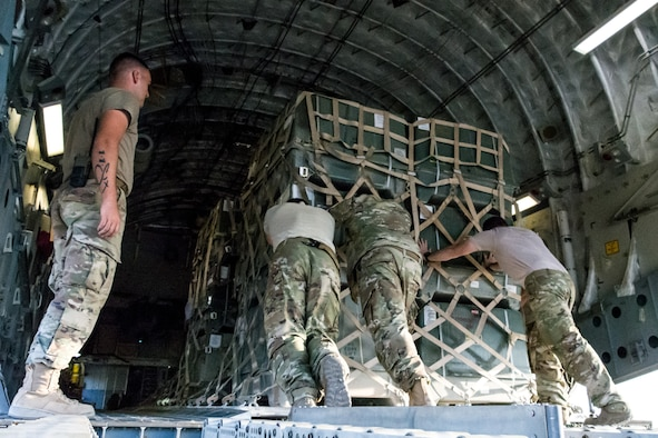 Personnel from the 816th Expeditionary Airlift Squadron and 332nd Air Expeditionary Wing offload cargo from a C-17 Globemaster III at an undisclosed location in Southwest Asia after being transported between U.S. Africa Command and U.S. Central Command, Aug. 28, 2018. Al Udeid-based aircraft have completed nearly 15 missions this calendar year between the two commands. (U.S. Air Force photo by Tech. Sgt. Ted Nichols/Released)