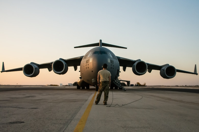 A C-17 Globemaster III is prepared for departure at an undisclosed location in Southwest Asia after transporting cargo between U.S. Africa Command and U.S. Central Command, Aug. 28, 2018. Al Udeid-based aircraft have completed nearly 15 missions this calendar year between the two commands. (U.S. Air Force photo by Tech. Sgt. Ted Nichols/Released)