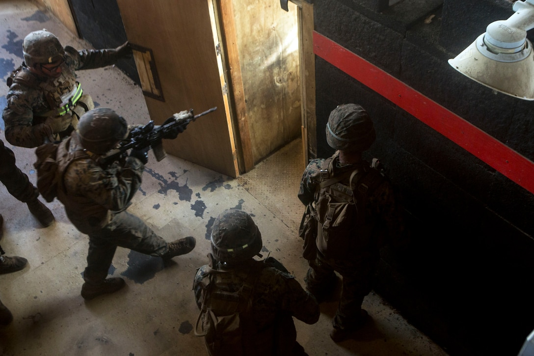 Marines prepare to clear a room during a training exercise.