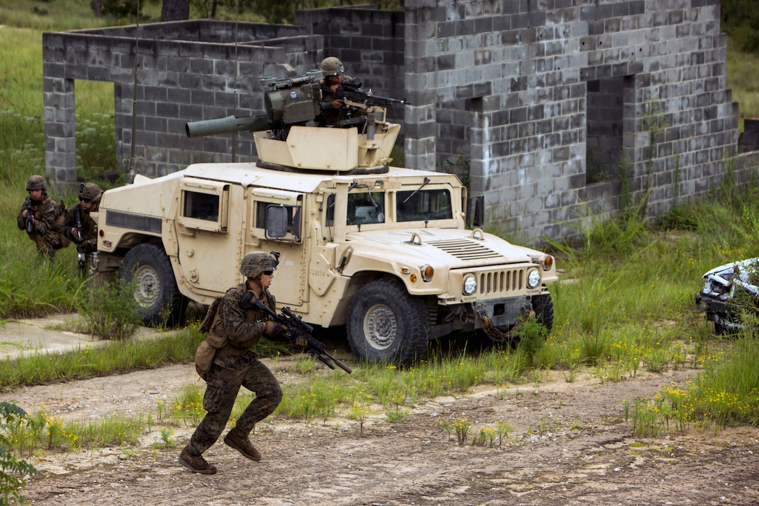 Marines move toward an objective during military operations in urban terrain training.