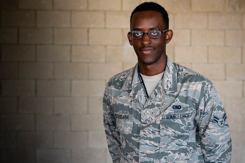 An airman poses for a photo.
