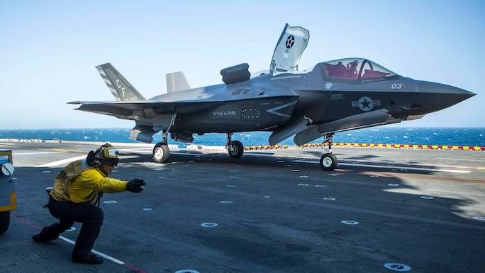 U.S. Navy Sailor Petty Officer 3rd Class Alexander Turla, an airman with the Essex Amphibious Ready Group, launches an F-35B Lightning II from Marine Fighter Attack Squadron 211, 13th Marine Expeditionary Unit, aboard the Wasp-class amphibious assault ship USS Essex, September 3, 2018. The Essex is the flagship for the Essex ARG and, with the embarked 13th MEU, is deployed to the U.S. 5th Fleet area of operations in support of naval operations to ensure maritime stability and security in the Central Region, connecting the Mediterranean and the Pacific through the western Indian Ocean and three strategic choke points.