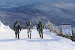 Maj. Matthew Wignall and members of his unit hike down Jay Peak when he was the commander of Alpha Troop, 1st Squadron, 172nd Cavalry Regiment, Vermont Army National Guard, Jan. 26, 2013. (U.S. Army photo by Sgt. Nathan Rivard/Released)
