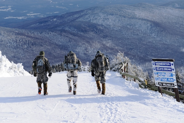 Soldiers hiking down Jay Peak, Vermont in snow.