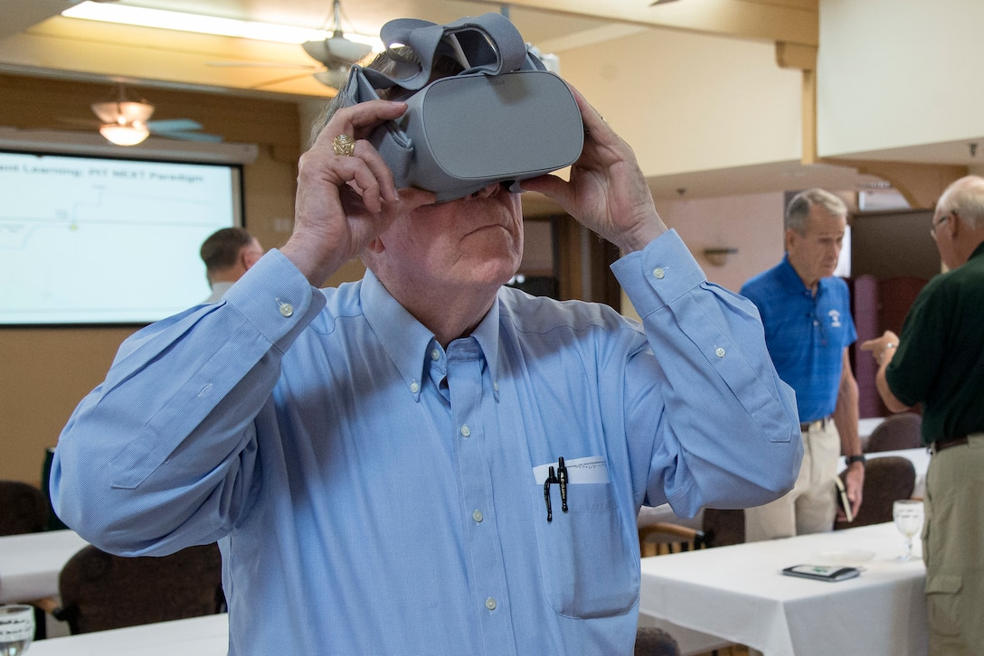 One of more than 40 veteran Air Force aviators tries on a set of virtual reality goggles Aug. 27, 2018 at the Parr Club on Joint Base San Antonio-Randolph, Texas.