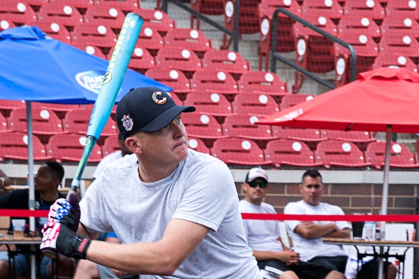 Joel Nickelson, 74th Air Refueling Squadron, concentrates as he takes a cut during an inter-service homerun derby contest held Aug. 18th at the Kokomo Municipal Park in Kokomo, Ind. Teams from the Army, Navy, Air Force and Marines engaged in the friendly competition. (U.S. Air Force photo/ Douglas Hays)