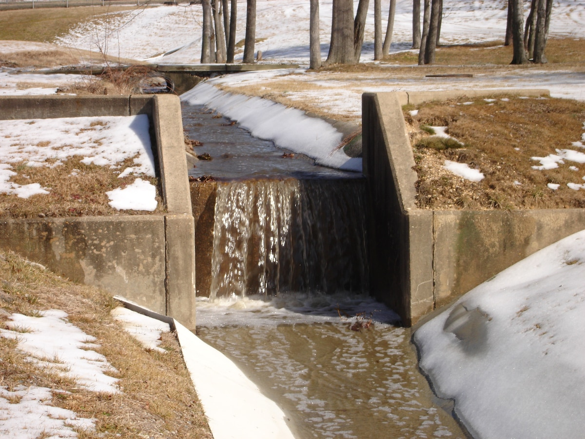 Photograph of snow runoff flowing away