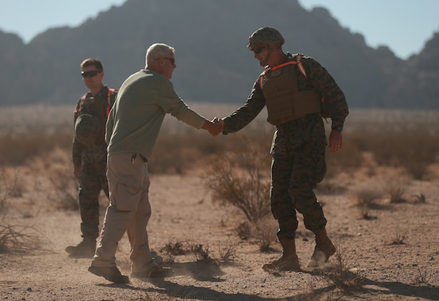 Brig. Gen. Roger Turner, Combat Center Commanding General, greets Jim Ricker, director, Government and External Affairs, prior to the ribbon cutting ceremony and live-fire demonstrations of the newly opened Johnson Valley Exclusive Military Use Area aboard the Marine Corps Air Ground Combat Center, Twentynine Palms, Calif., Aug. 24, 2018. The EMUA is open to all Marine Corps units and will allow for a more realistic level training that is capable of accommodating an entire Marine Air Ground Task Force. (U.S. Marine Corps photo by Sgt. Medina Ayala-Lo)