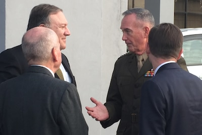 Secretary of State Mike Pompeo, left, speaks with Marine Corps Gen. Joe Dunford.
