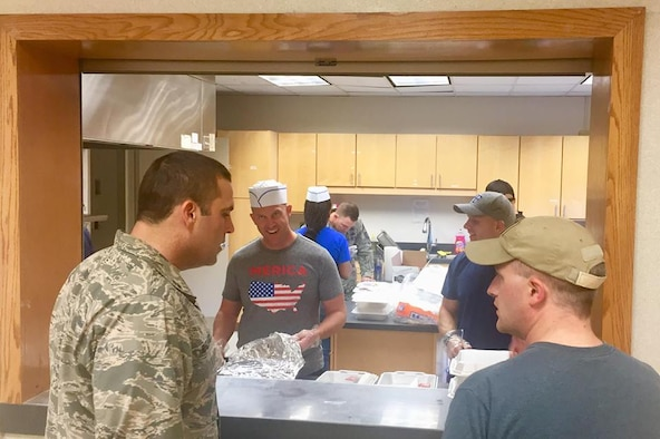 PETERSON AIR FORCE BASE, Colo. -- Master Sgt. Scott Lauer, 21st Force Support Squadron first sergeant, delivers a full pancake breakfast to hungry Airmen at the Chapel, Aug. 30, 2018, at Peterson Air Force Base, Colorado. First Sergeants from around the base came together to prepare, cook and deliver pancake breakfasts to Airmen across the installation. (U.S. Air Force Photo by Alethea Smock)