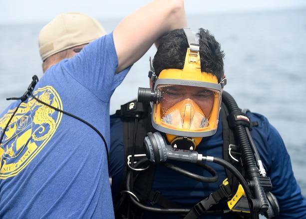 A U.S. Navy diver prepares to dive.