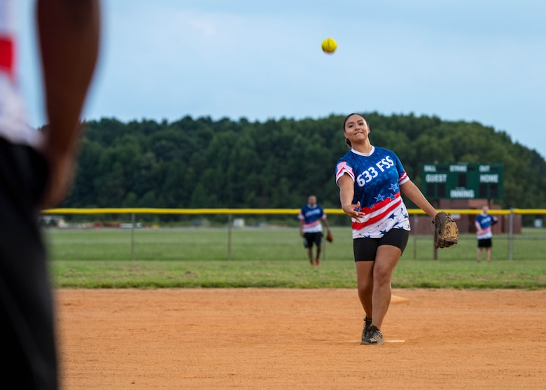 U.S. Air Force Airman 1st Class Daniella Cortez, 633rd Force Support Squadron commander support staff journeyman pitches the ball during the intramural softball championship at Joint Base Langley-Eustis, Virginia, Aug. 30, 2018.