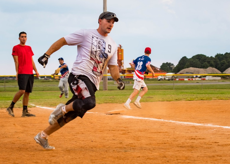 U.S. Air Force Staff Sgt. Nicholas Matzdorf, 30th Intelligence Squadron imagery missions' supervisor runs towards home plate during the intramural softball championship at Joint Base Langley-Eustis, Virginia, Aug. 30, 2018.