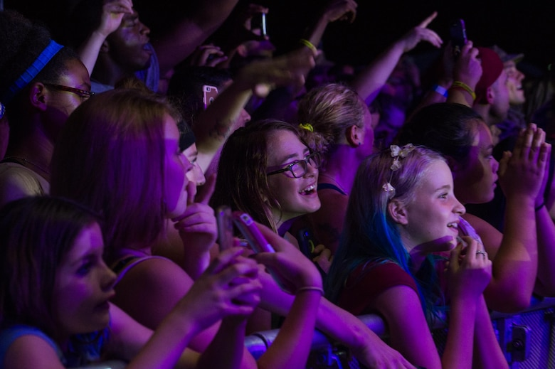 Spectators watch as the X Ambassadors perform during the End of Summer Music Festival at Joint Base Langley-Eustis, Virginia, Sep. 1, 2018.