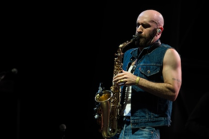 Sam Harris, X Ambassadors lead vocalist, plays the saxophone during the End of Summer Music Festival hosted by Air Force Services Activities at Joint Base Langley-Eustis, Virginia, Sep. 1, 2018.