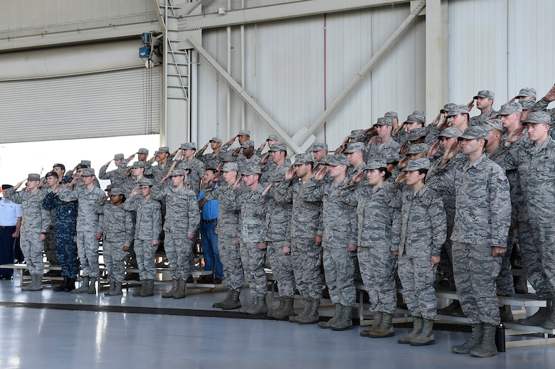 Members of Joint Base Charleston salute during the national anthem at a change of command ceremony Sept. 5, 2018, at Joint Base Charleston, S.C. During the ceremony, Col. Terrence Adams replaced Col. Jeff Nelson as 628th Air Base Wing commander and Joint Base Charleston commander. Joint Base Charleston is one of 12 Department of Defense joint bases and is host to over 60 DOD and federal agencies. The 628th ABW delivers installation support to over 90,000 Airmen, Sailors, Soldiers, Marines, Coast Guardsmen, civilians, dependents and retirees across four installations including the Air Base and Naval Weapons Station.