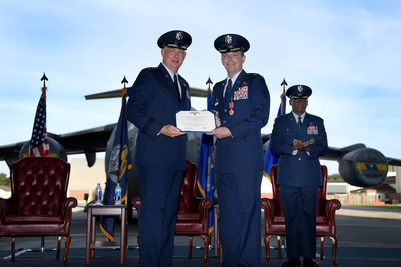 Col. Jeffrey Nelson, center, outgoing commander of the 628th Air Base Wing, receives the Legion of Merit medal from Maj. Gen. John Gordy II, left, U.S. Air Force Expeditionary Center commander, during a change of command ceremony Sept. 5, 2018, at Joint Base Charleston, S.C.