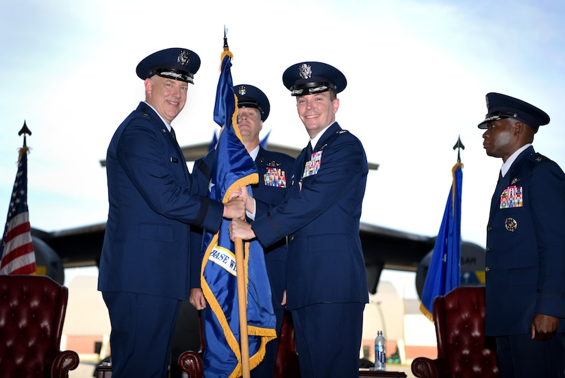 Col. Jeff Nelson, center right, relinquishes command of the 628th Air Base Wing and Joint Base Charleston to Maj. Gen. John Gordy II left, U.S. Air Force Expeditionary Center commander, during a change of command ceremony Sept. 5, 2018, at Joint Base Charleston, S.C. Col. Terrence Adams, right, replaced Nelson as commander of the wing and joint base. Joint Base Charleston is one of 12 Department of Defense joint bases and is host to over 60 DOD and federal agencies. The 628th ABW delivers installation support to over 90,000 Airmen, Sailors, Soldiers, Marines, Coast Guardsmen, civilians, dependents and retirees across four installations including the Air Base and Naval Weapons Station.