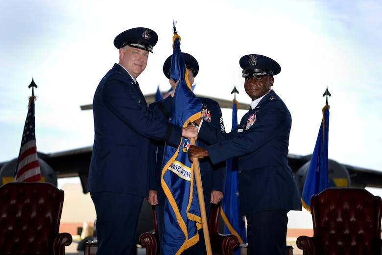 Col. Terrence Adams, right, assumes command of the 628th Air Base Wing and Joint Base Charleston from Maj. Gen. John Gordy II, left, U.S. Air Force Expeditionary Center commander, during a change of command ceremony Sept. 5, 2018, at Joint Base Charleston, S.C. Adams replaced Col. Jeff Nelson as commander of the wing and joint base after serving at Scott Air Force Base, Ill., as Air Mobility Command's director of communications and chief information officer. Joint Base Charleston is one of 12 Department of Defense joint bases and is host to over 60 DOD and federal agencies. The 628th ABW delivers installation support to over 90,000 Airmen, Sailors, Soldiers, Marines, Coast Guardsmen, civilians, dependents and retirees across four installations including the Air Base and Naval Weapons Station.