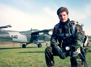 John Chapman  in front of small plane