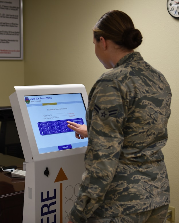 U.S. Air Force Airman 1st Class Zoie Rider, 56th Fighter Wing Public Affairs photojournalist, checks in with the new kiosk at the 56th Force Support Squadron Military Personnel Flight customer service office Aug. 29, 2018 at Luke Air Force Base, Ariz.