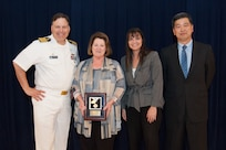 Rita M. Terhaar, Carderock's Human Resources director, receives the Rear Adm. Grace M. Hopper Award for excellence in organizational support at the Naval Surface Warfare Center, Carderock Division Honor Awards ceremony Aug. 28, 2018, in West Bethesda, Md. From left to right: Commanding Officer Capt. Mark Vandroff; Terhaar; Tamar Gallagher, head of Carderock's Corporate Operations Department; and Dr. Paul Shang, Carderock's acting technical director. (U.S. Navy photo by Nicholas Brezzell/Released)