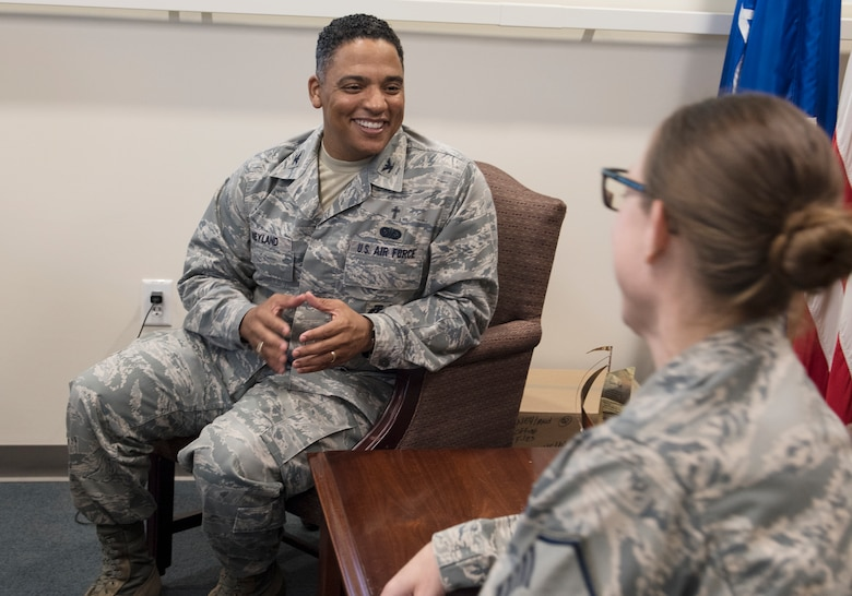 Chaplain (Col.) Shon Neyland, Pacific Air Forces Command Chaplain, speaks with Master Sgt. Kristen Allen, religious affairs, in his office at Headquarters PACAF, Joint Base Pearl Harbor-Hickam, Hawaii, Sept. 5, 2018.